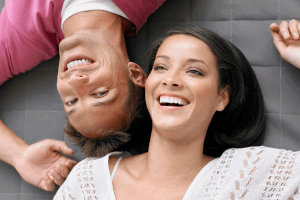 couple laughing while lying down