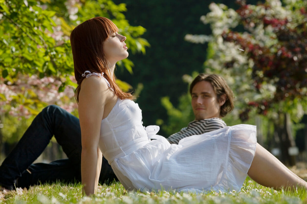 couple lying on the grass in the sun