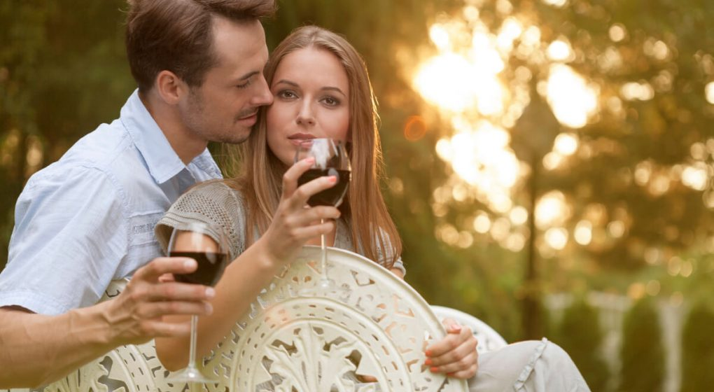 couple drinking wine in the garden