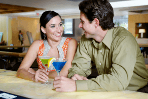 couple chatting in a bar over a drink