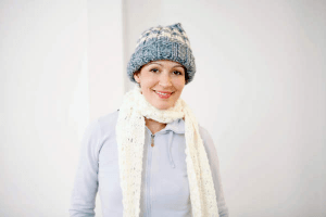 woman in hat and scarf looking very independant
