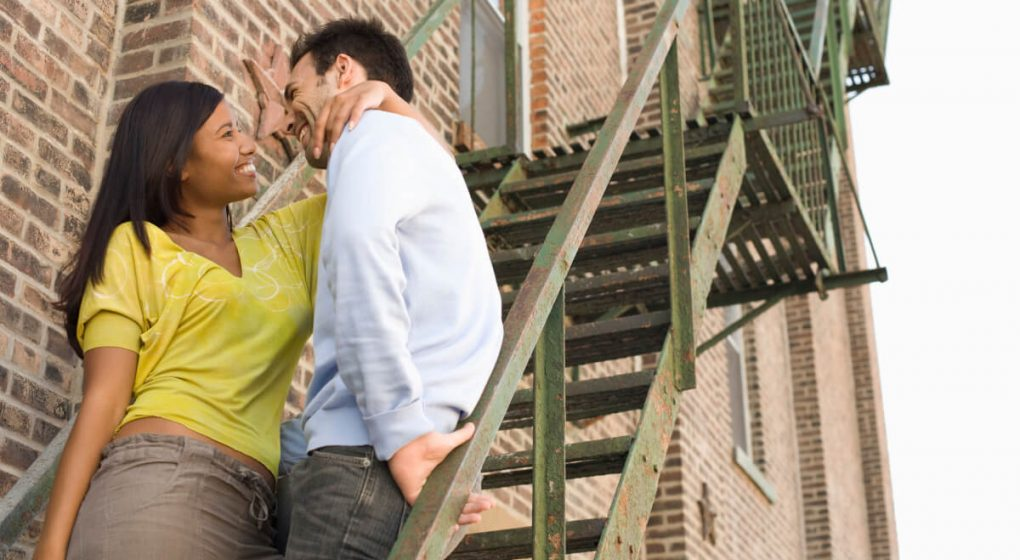 Man and woman talking on a flight of stairs