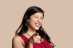 Smiling woman in red dress pointing her finger