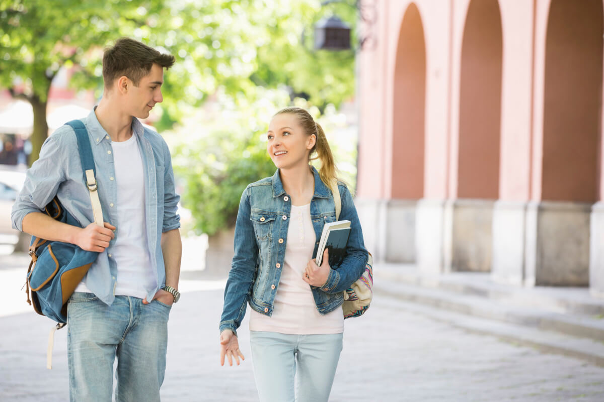 Couple chatting happily as they walk together
