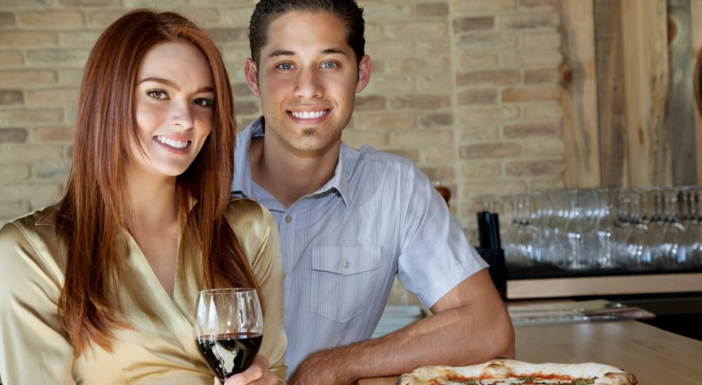 man with woman drinking red wine