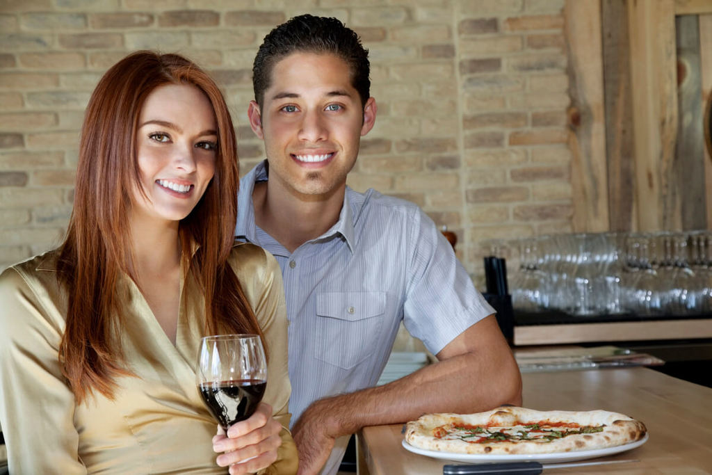 man with woman on a date drinking red wine