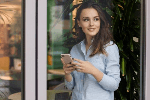 Woman with cell phone texting a Taurus man