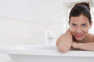 Woman in the bath secretly thinking how to turn on a virgo man