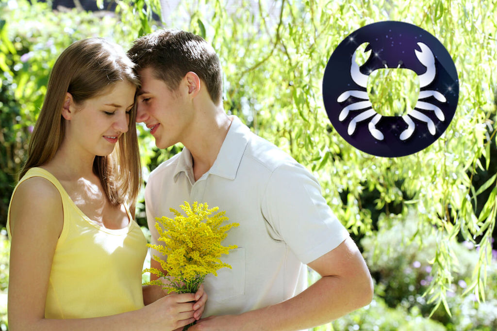 Man giving a woman a bunch of yellow flowers