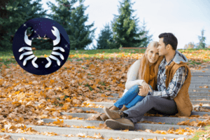 Cancer compatibility shines through with this couple sitting on steps covered in autumn leaves