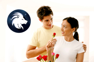 Woman has found her Leo compatibility partner as he smiles while presenting her with red roses