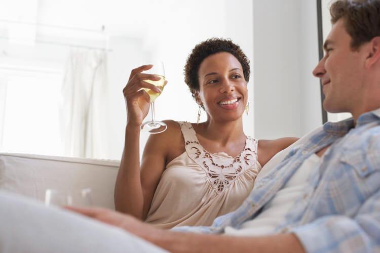 woman drinking wine with a man born under the astrologic sign of Venus in Cancer