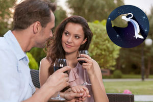 Man and woman drinking wine together