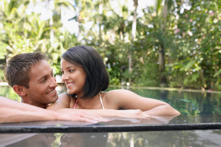 Libra compatibility as shown by two people of the same birth sign swimming in a pool
