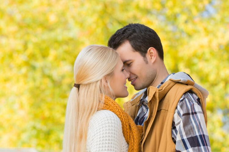 Woman about to kiss her Aries man