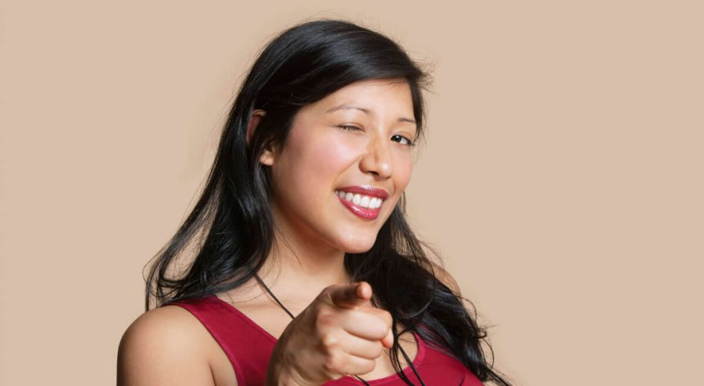 Confident brunet woman pointing her finger