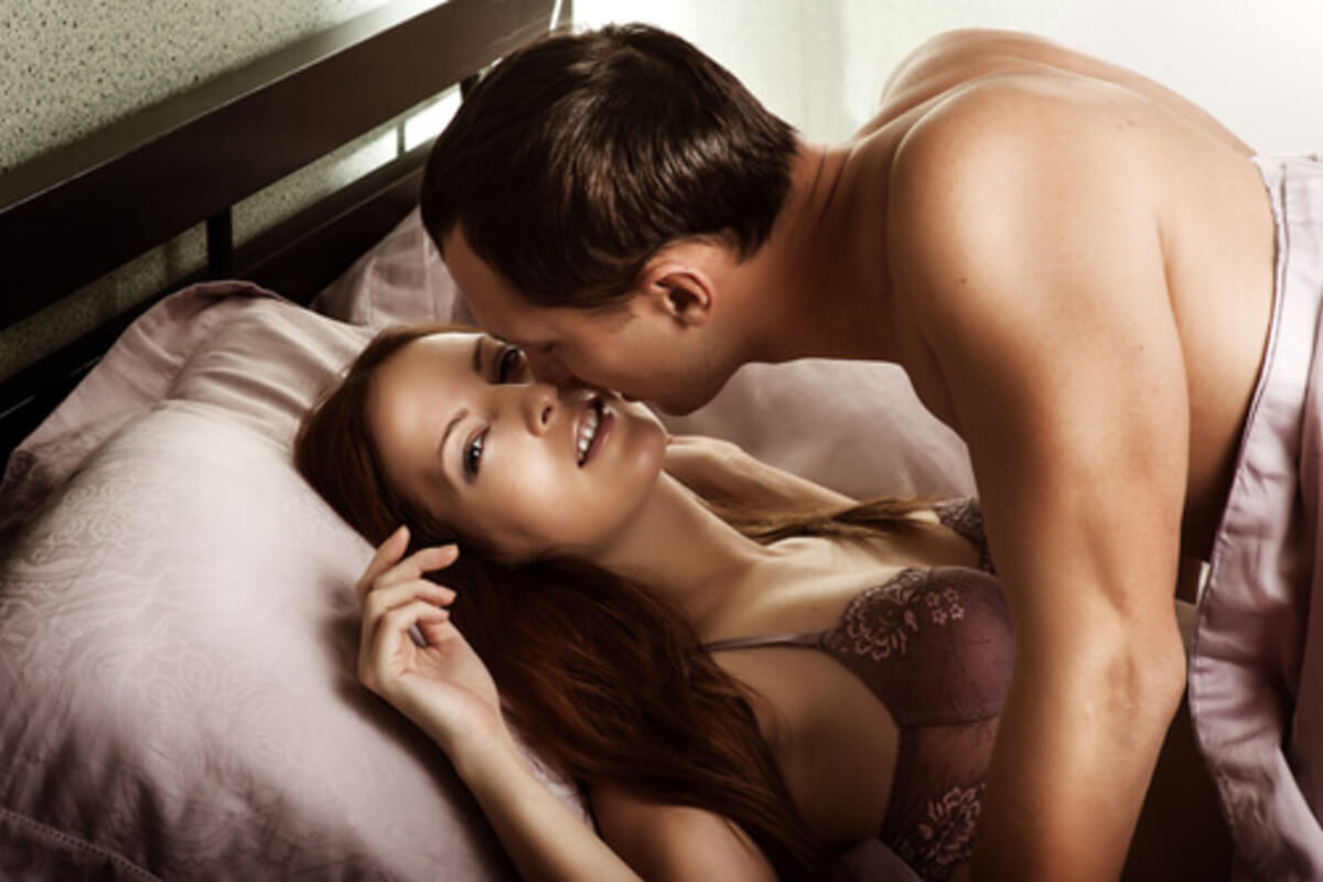 woman and her Pisces man making love in bed