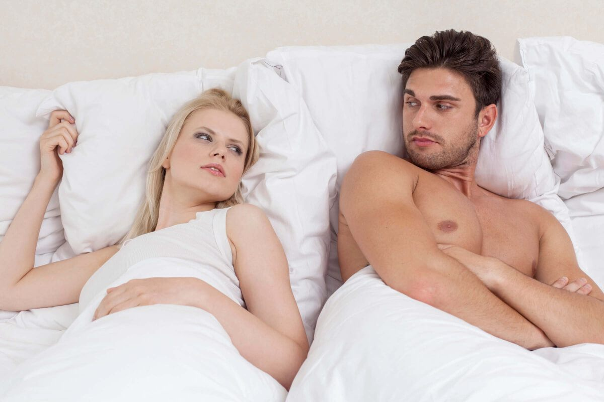 Man with his girlfriend in bed