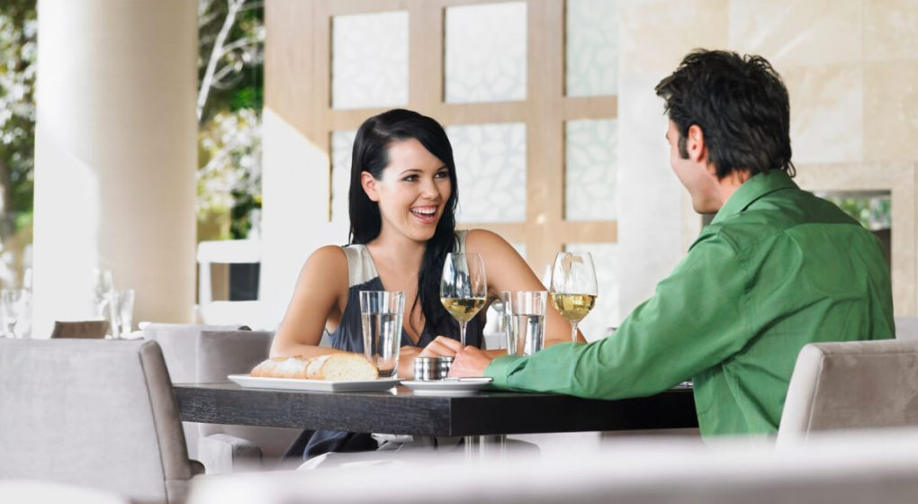 A woman dating a man in a restaurant