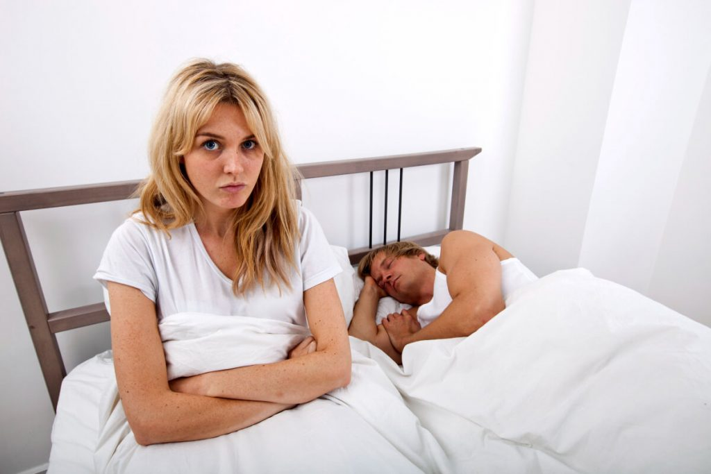 A woman being ignored by her boyfriend
