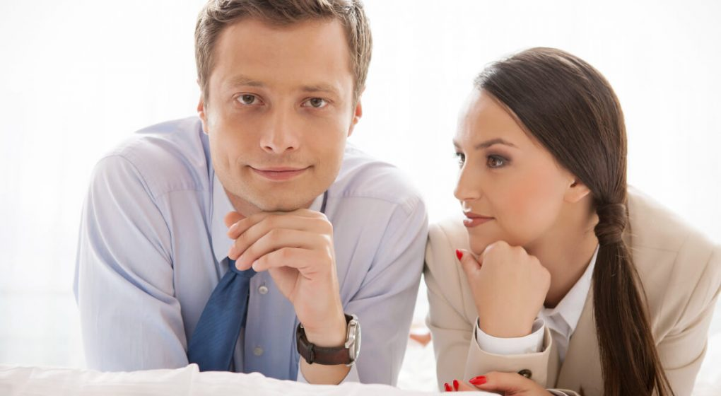 woman looking longingly at man who seems to be ignoring her